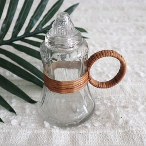 Vintage syrup glass bottle with rattan han…